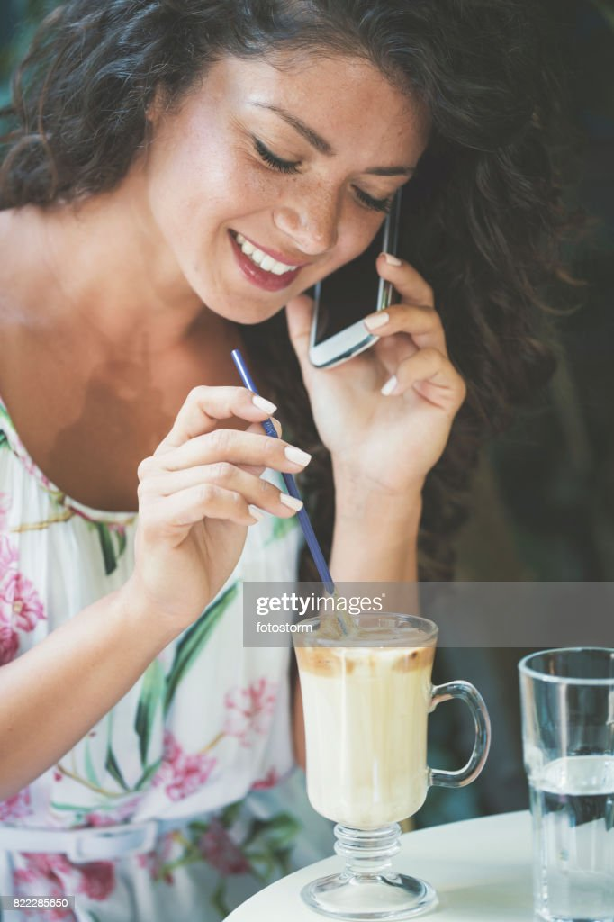 Woman using phone in safe garden : Stock Photo