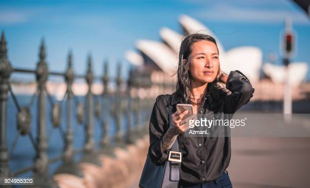 Woman using phone in Sydney