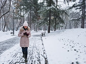 young woman using telephone snow covered