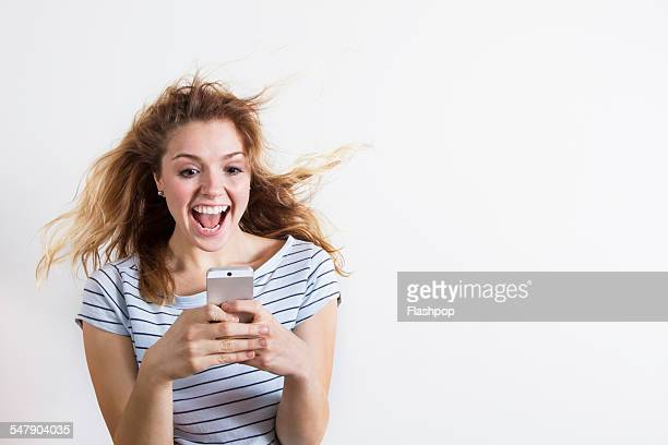 woman using phone - excitement stock pictures, royalty-free photos & images