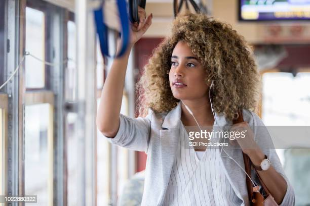 woman using public transportation - rush hour stock pictures, royalty-free photos & images