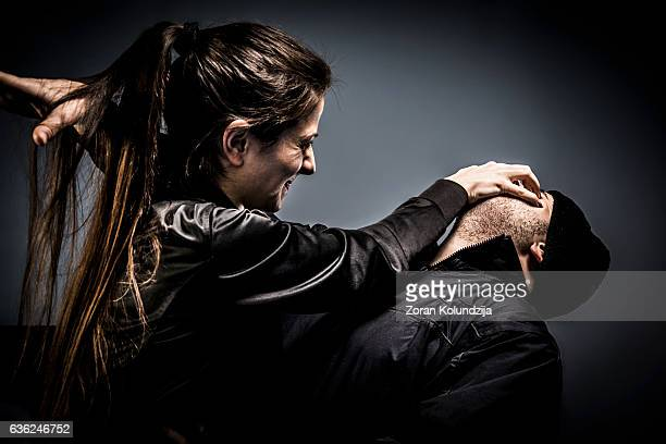 woman using self defense technique against attacker - mujer violada fotografías e imágenes de stock