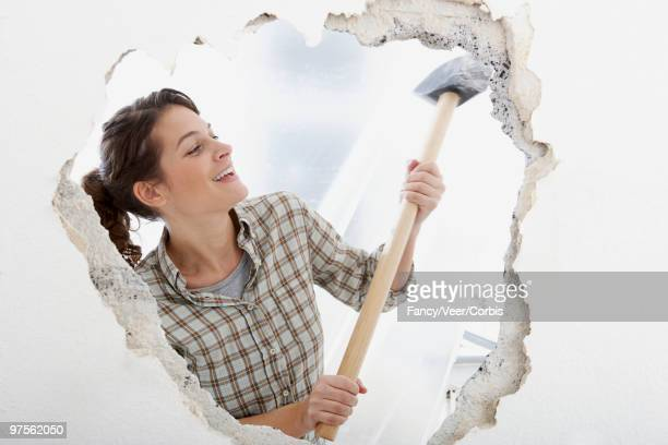 Woman using sledgehammer