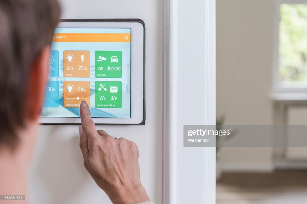 Woman Using Smart Home Screen Stock Photo - Getty Images