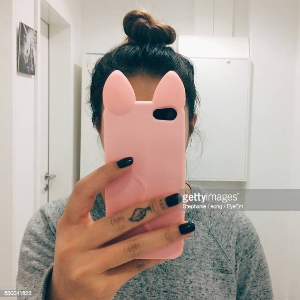 woman using smart phone at home - black nail polish stock photos and pictures