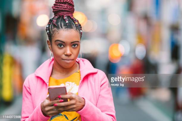 woman using smart phone at night - millennial pink stock pictures, royalty-free photos & images