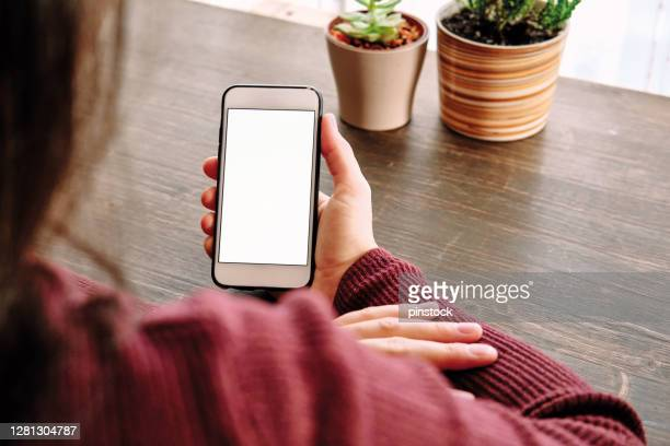 woman using smart phone. human hand and smart phone close-up shooting. - iphone mockup stock pictures, royalty-free photos & images