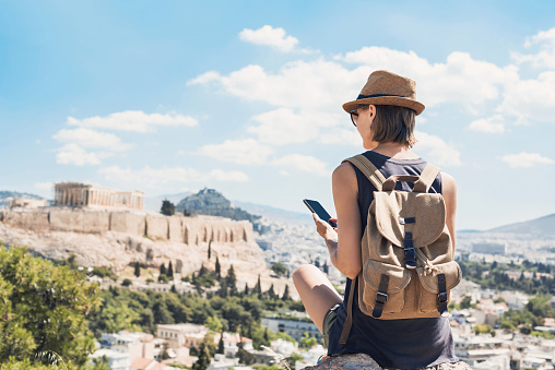 Woman using smart phone on vacations in Athens 1161906433