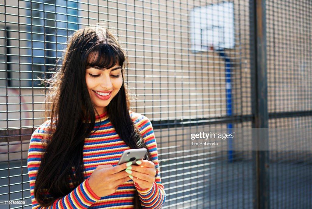 woman using smart phone outside : Stock Photo