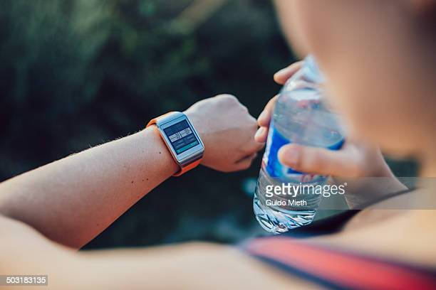 Woman using smart watch after workout.
