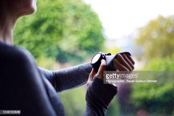 a woman using smart watch - time stock pictures, royalty-free photos & images