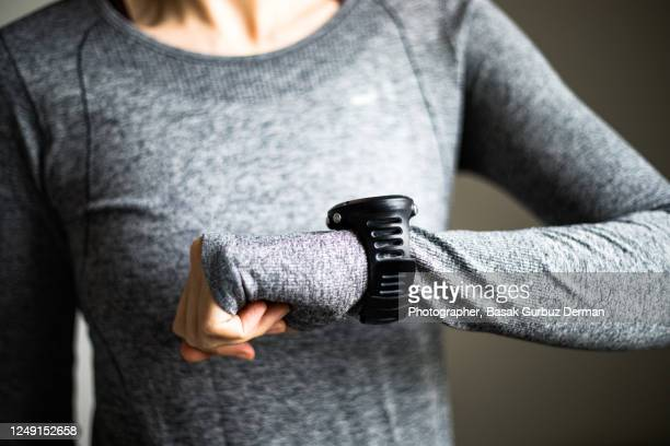 a woman using smart watch - wearable computer stock pictures, royalty-free photos & images