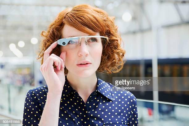 Woman using Smart-Glass.