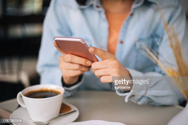 woman using smartphone close up - phone message stock pictures, royalty-free photos & images