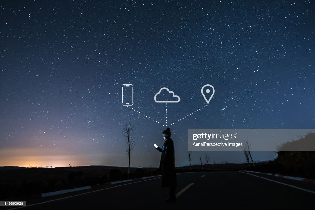 Woman Using Smartphone in starry Night : Stock Photo