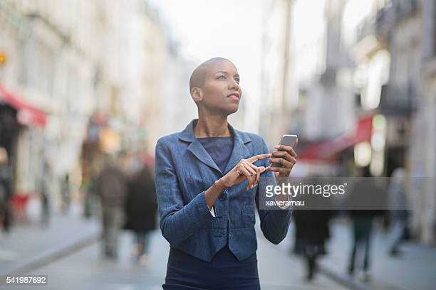Woman using smartphone in the city