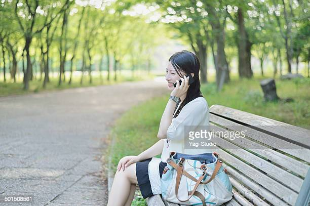 Woman using smartphone in the park