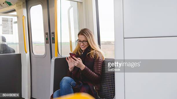 Woman Using Smartphone on Train