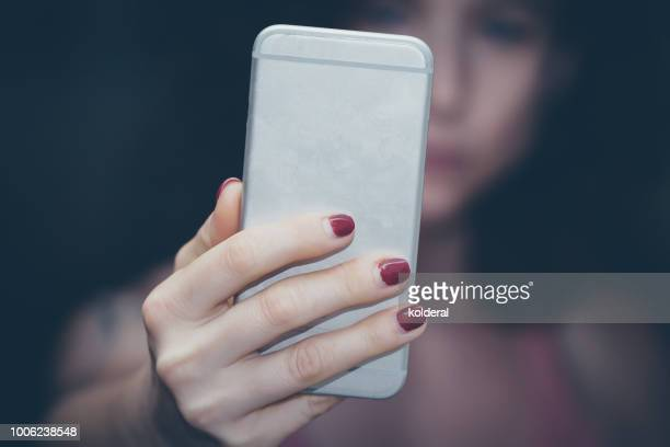 woman using smartphone - sending stock pictures, royalty-free photos & images