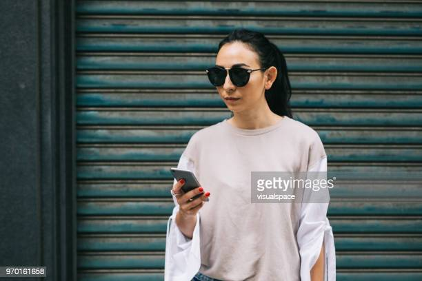 woman using smartphone with copy space - eurasia stock pictures, royalty-free photos & images