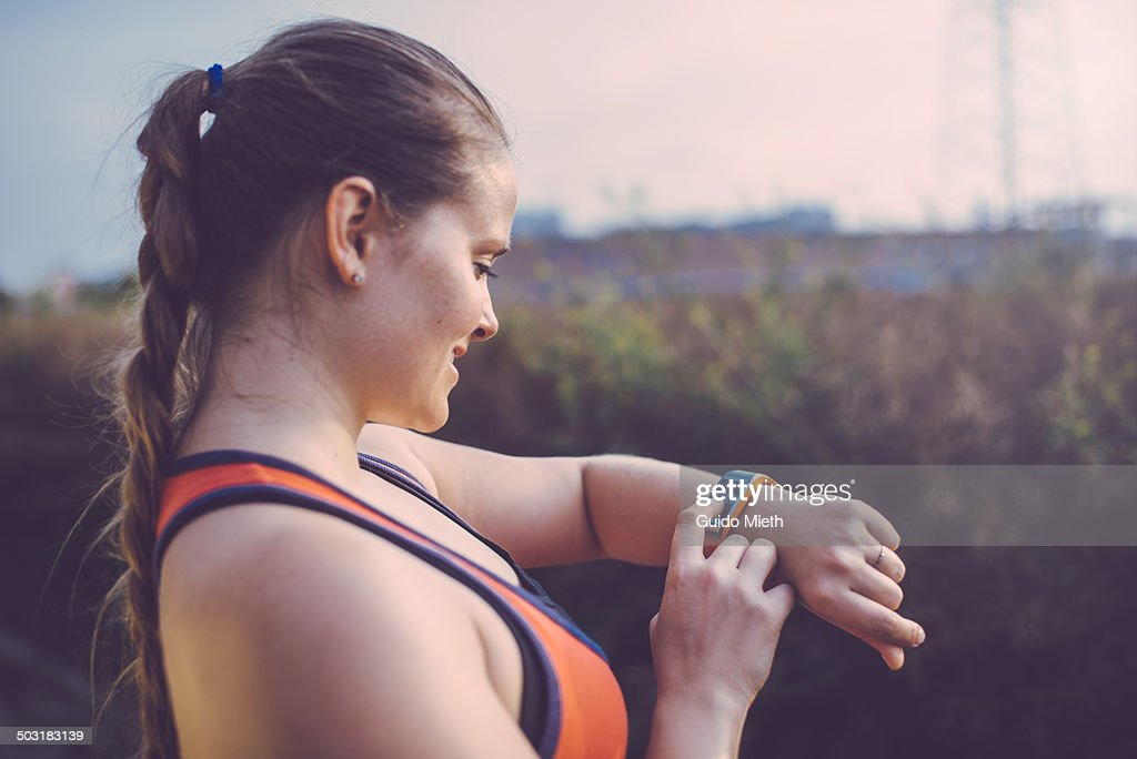 Woman using smartwatch outdoor. : Stock Photo