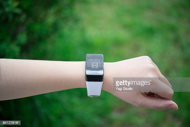 Woman using smartwatch.