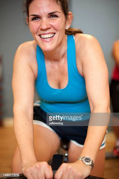 Woman using spin machine in gym