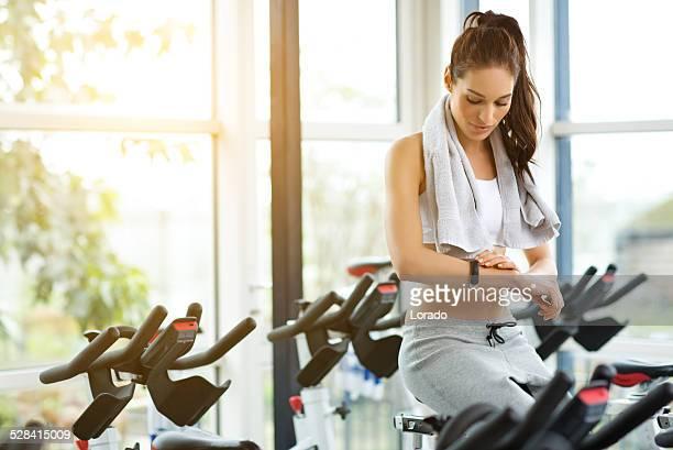 woman using sport bracelet during exercising