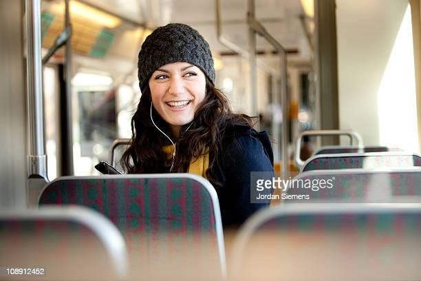 woman using streetcar in city. - tram stockfoto's en -beelden