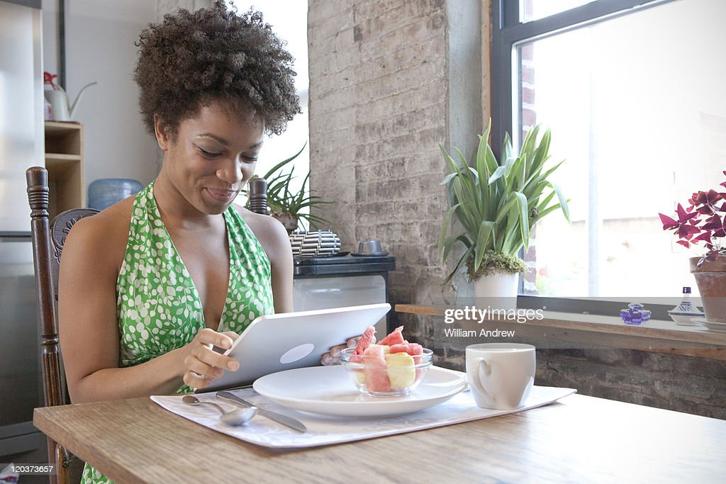 Woman using table computer : Stock Photo