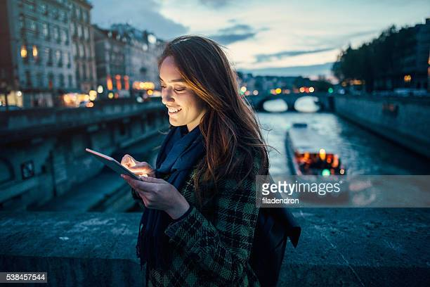 woman using tablet at night - touchpad stock pictures, royalty-free photos & images