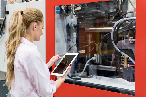 Woman using tablet & cnc machine - gettyimageskorea
