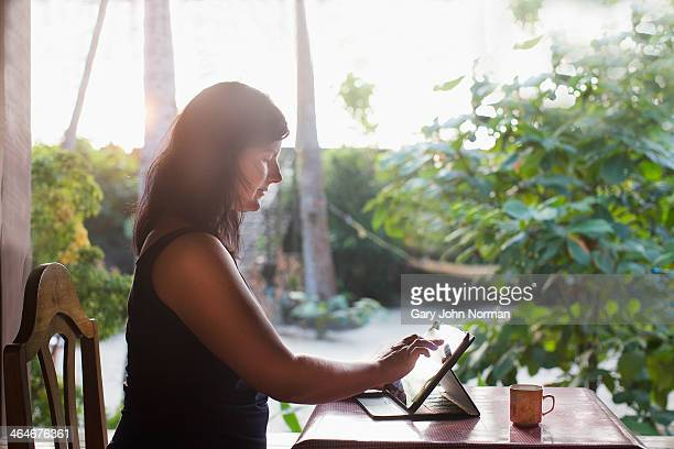 Woman using ipad at Homestay in India