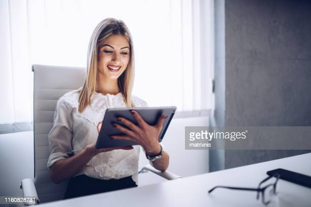 Woman using tablet in her office
