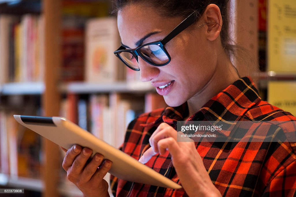 Woman using tablet : Stock Photo