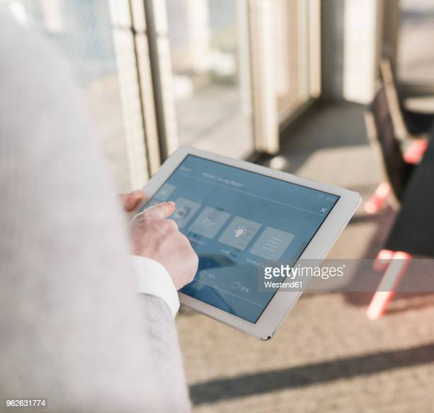 woman using tablet with smart home control functions in office - energy efficient stock pictures, royalty-free photos & images