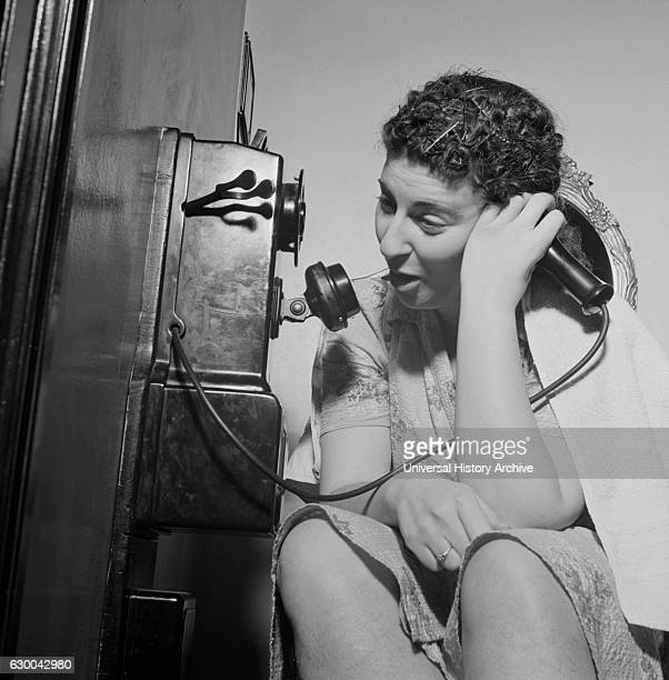 Woman Using Telephone in Boardinghouse Washington DC USA Esther Bubley for Office of War Information January 1943