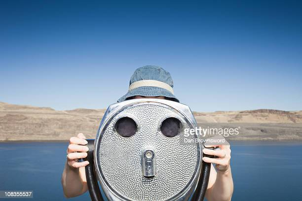 Woman using telescopic viewer