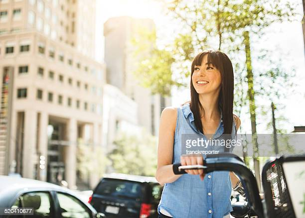 woman using the bicycle in montreal - tourism stock pictures, royalty-free photos & images