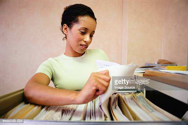 Woman using the filing cabinet