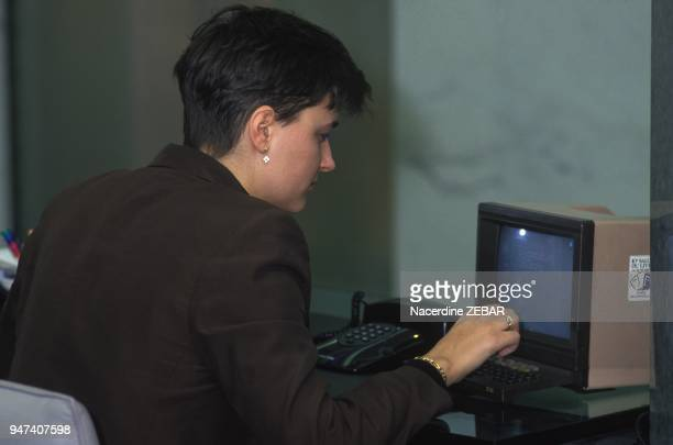 A woman using the Minitel a videotex online service accessible through the telephone lines it was launched in France in 1982 by the PTT January 9 1991