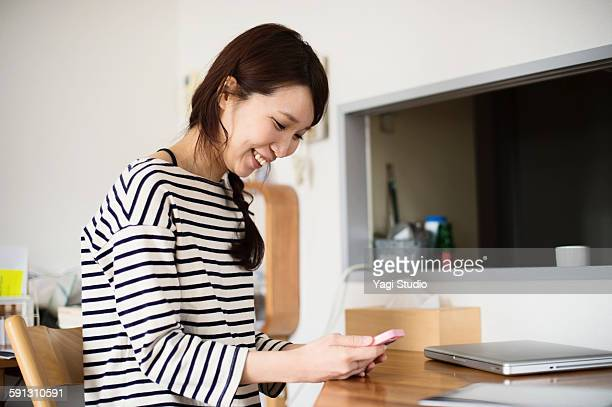 Woman using the smartphone in room