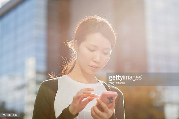 Woman using the smartphone in the city