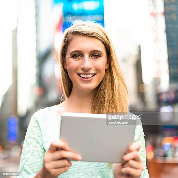 woman using the tablet in times square - NYC