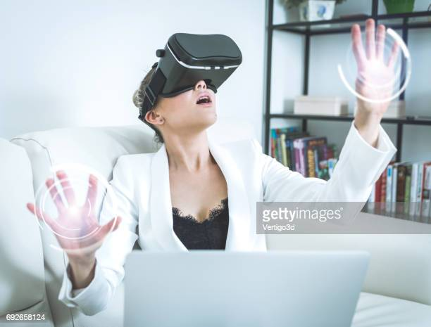 Woman using virtual reality futuristic touchscreen display interface