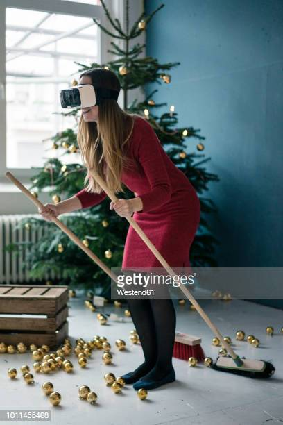 woman using virtual reality glasses at christmas time - a sense of home stock photos and pictures