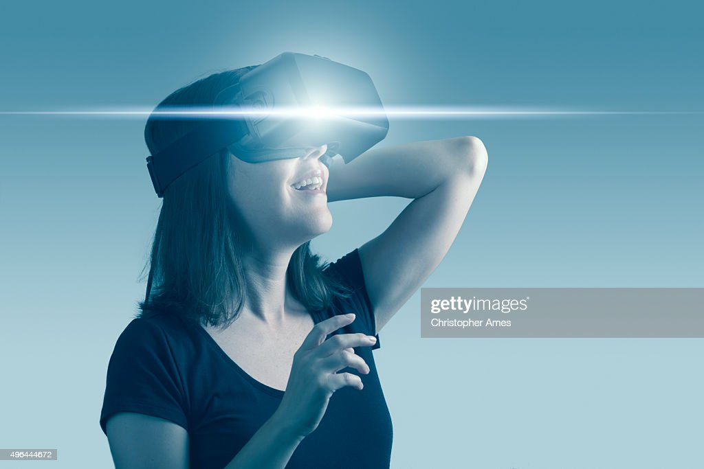 Woman Using Virtual Reality Headset : Stock Photo