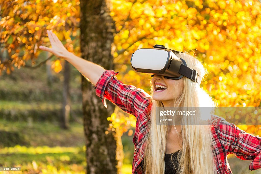 Woman using VR headset & laughing : Stock Photo