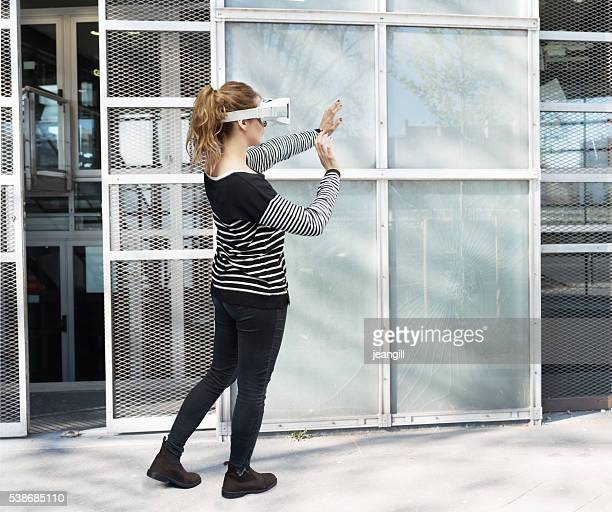 Woman using VR simulator in urban setting