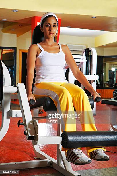Woman using weight machine